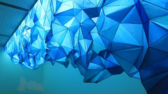 A Glowing Iceberg Made Entirely Of Staples And Tissue Paper Gabby O'Connor further proves that tissue can be turned into something beautiful with a striking installation piece.