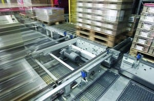 Pallet conveyor uses roller and chain surface to move pallets in production and warehousing environment.